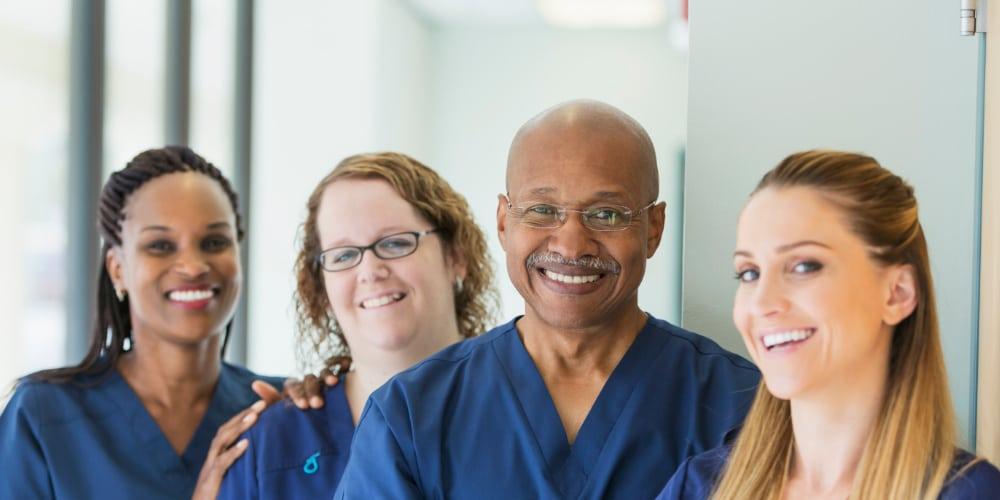 Man leading team of multi-ethnic medical professionals