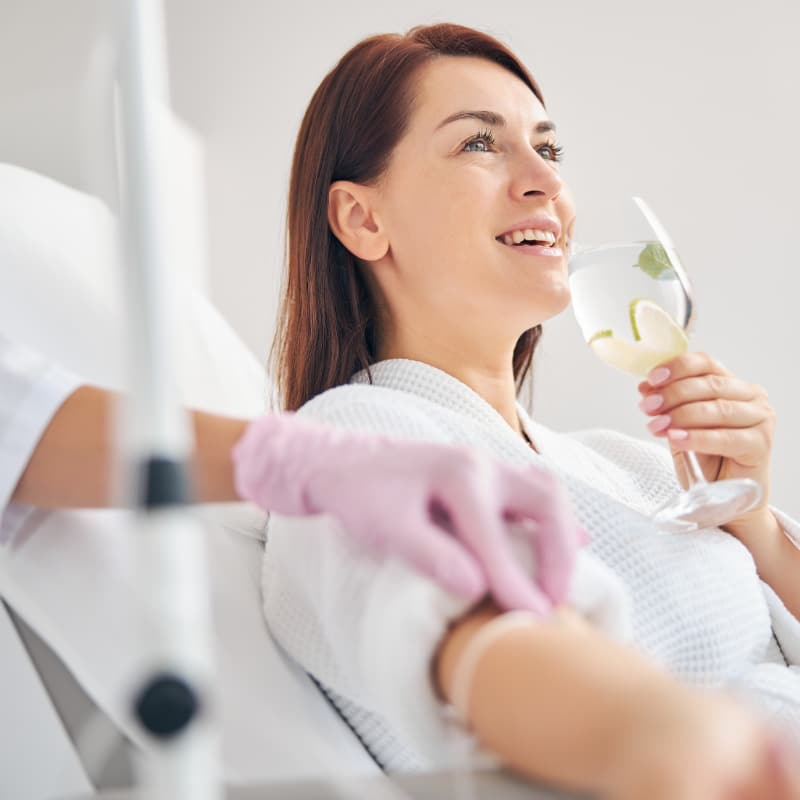 Woman smiling during the intravenous therapy